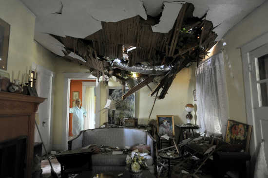 Frances Lukens Looks At The Tangle Of Boards And Tree Limbs Piercing Her  Living Room Ceiling In Lynchburg, Va. On Saturday, June 30, 2012 After A  Huge Oak ...