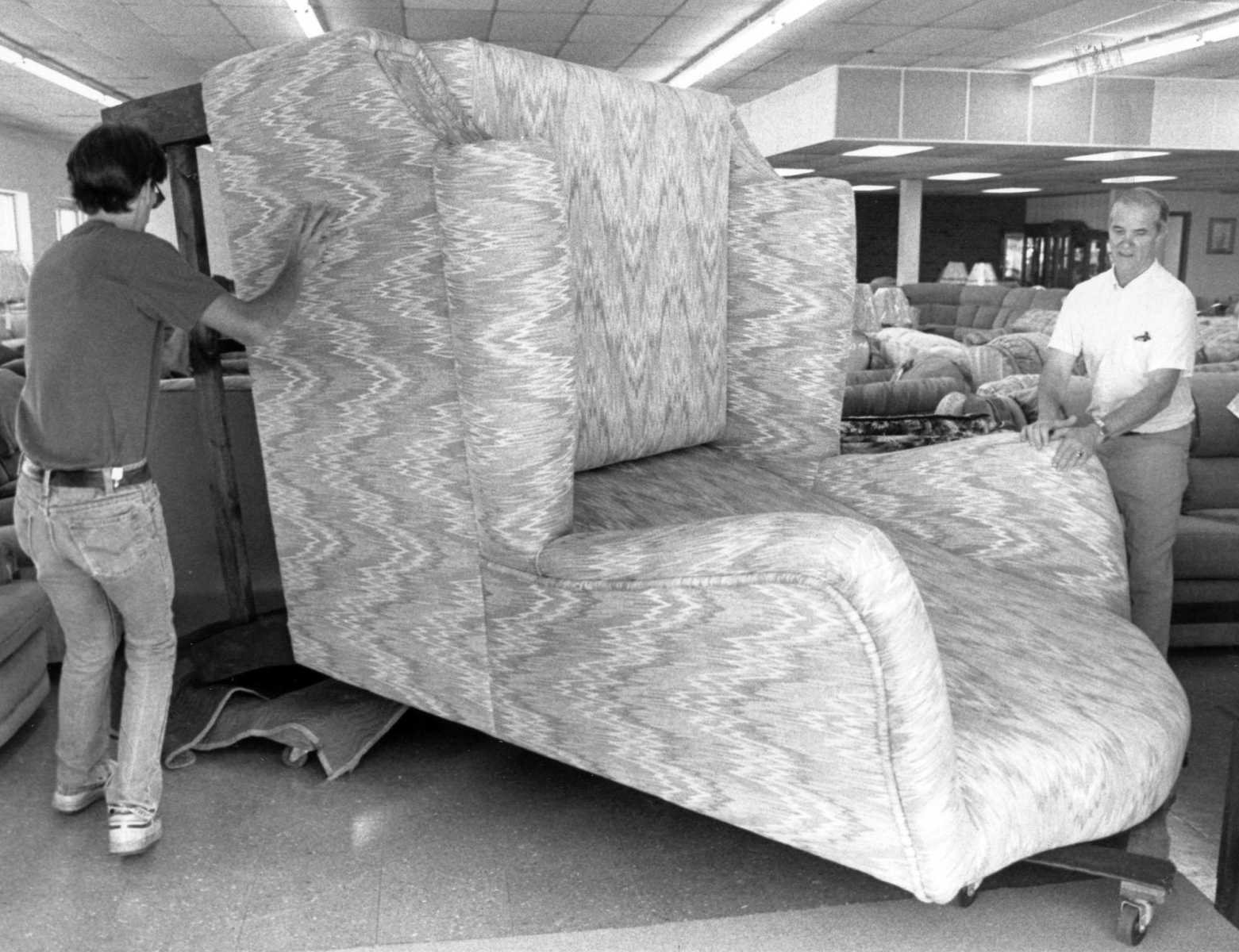 Harold Palmer, Left, And His Father, Jim Palmer, Owner Of Uncle Ralphu0027s  Furniture, Moved A 9 Foot Tall, Wing Back Chair Into Their New Location At  1739 N. ...