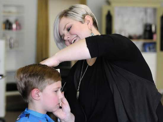 Shelby Allee trims Parker Estes' hair Friday at PLUSH Salon on Broadway in Cape  Girardeau.