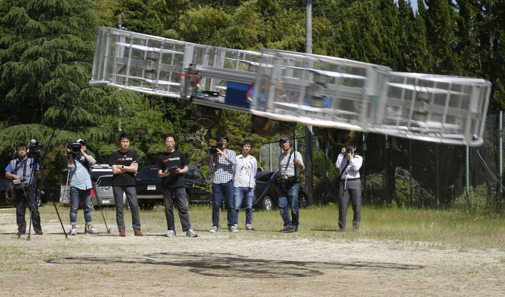 Tsubasa Nakamura, Project Leader Of Cartivator, Third From Left, Watches  The Flight Of The Test Model Of The Flying Car On A Former School Grounds  Saturday ...