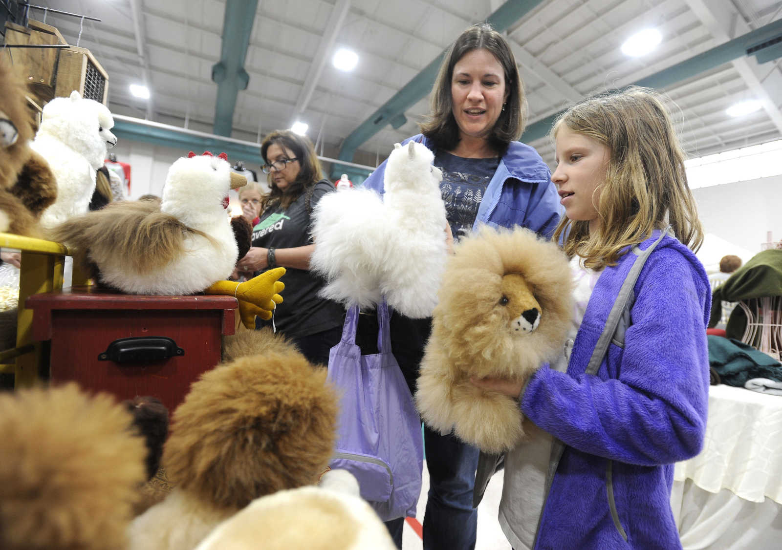 Diane Higgins and her daughter, Sarah Higgins, of Cape Girardeau ponder  which alpaca-hair stuffed animal they want Saturday, Nov. 18, 2017 at the  Christmas ...