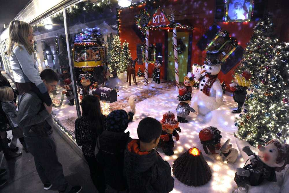 Justine Olson Views The Annual Christmas Window Display On Her Cousin  Nicholas McClardu0027s Shoulders Nov. 23 At Hutsonu0027s Fine Furniture In Downtown  Cape ...